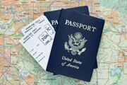 Airplane-boarding-passes-and-American-passports-over-map